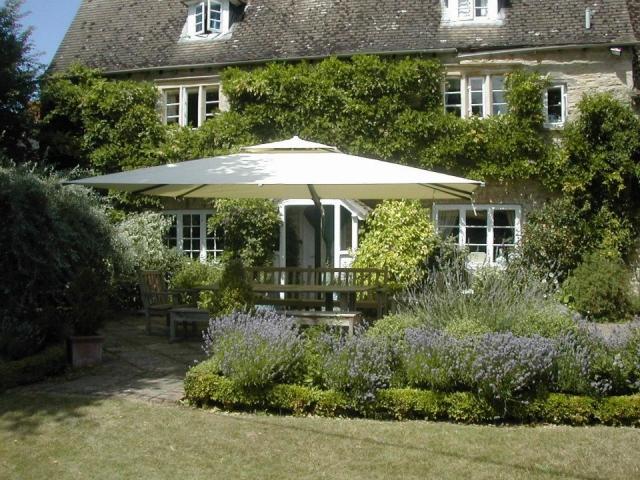 Piazza Side Arm Parasol in beautiful garden