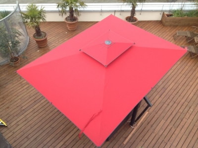 Garden parasol with bright red canopy