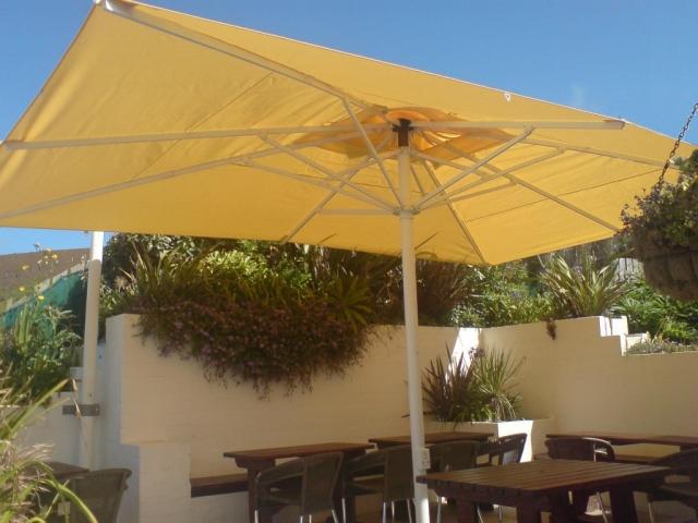 Clean umbrella against blue sky background