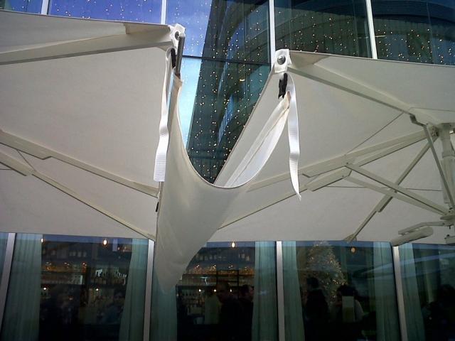 Junction 'gutters' for large pub umbrellas