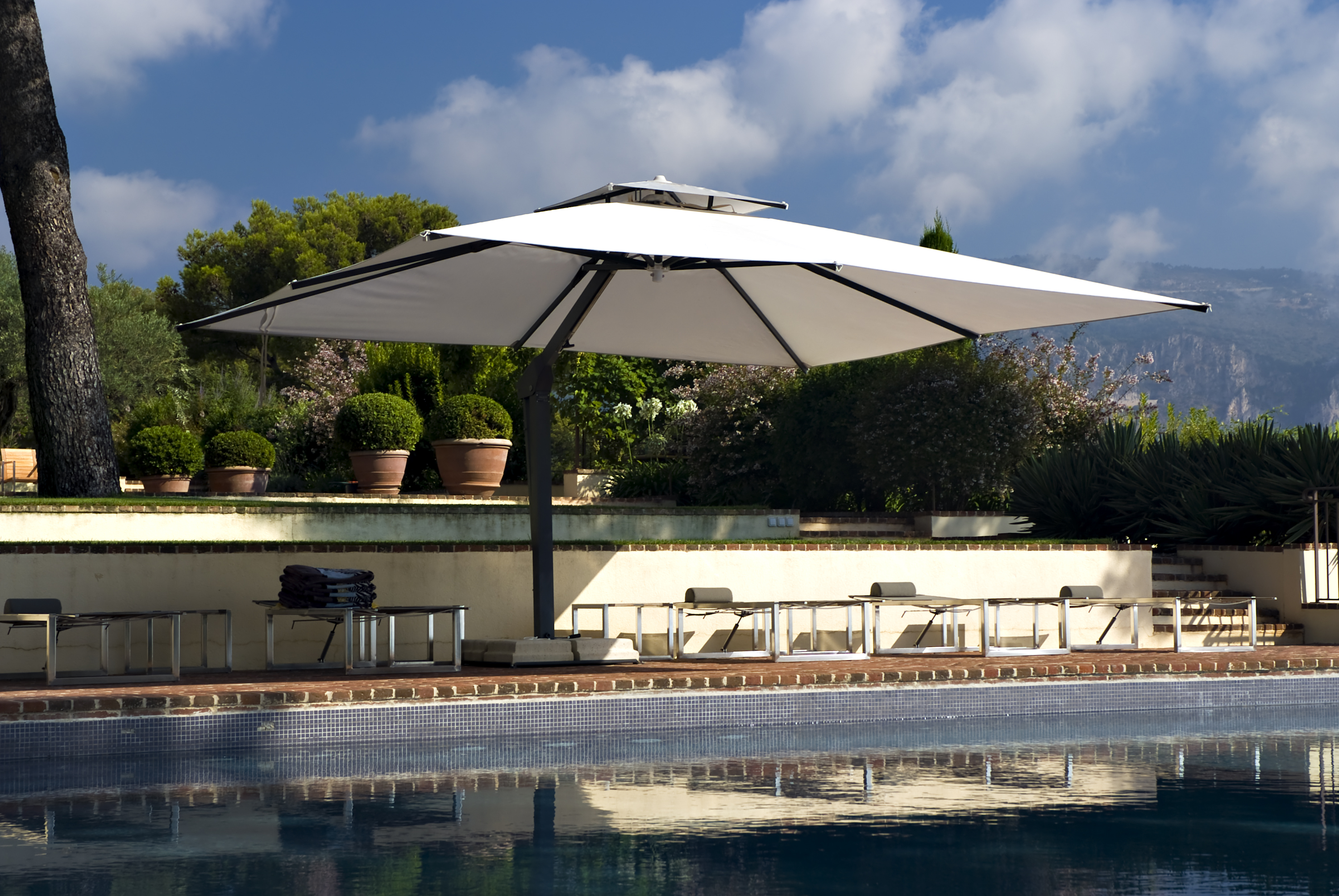 Large Cantilever Umbrella Over A Pool
