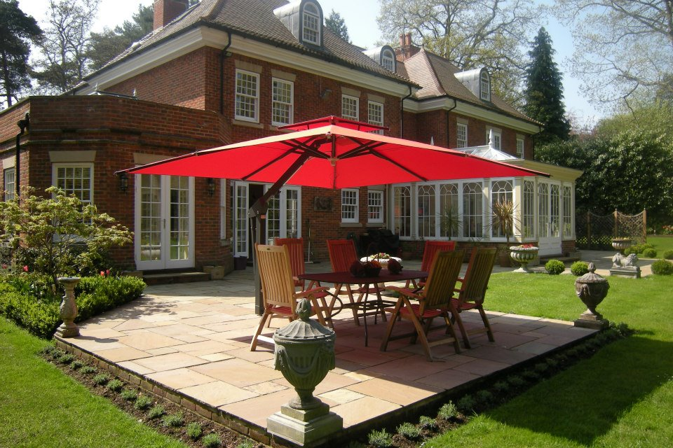 Bright red canopy of Piazza side arm umbrella
